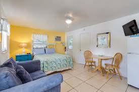 one room with a queen bed living area with a twin sleeper love seat kitchen area bathroom and screen lanai on water sleeps 3