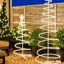 outdoor holiday lighting ideas. Outdoor Holiday Lighting With White Lighted Spiral Christmas Trees. Ideas