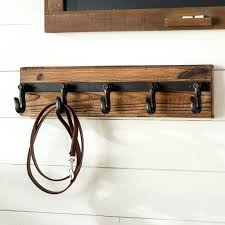 wall coat racks laurel foundry modern farmhouse wood and iron wall mounted coat rack intended for