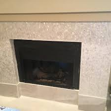 in fact traditionally they were installed in the center of the wall space to allow as many family members to gather around them as possible fireplace tiles