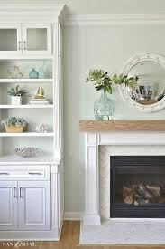 coastal family room and fireplace makeover one year after a flood come see what