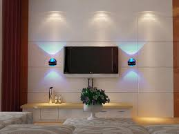 modern led wall lights with blue light on family room with a led tv plus a cupboards on below