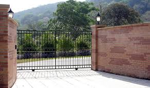 wrought iron fence brick. Wrought Iron Fence With Brick Posts And Outdoor Lightings