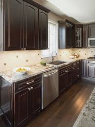 Granite Kitchen Flooring Kraftmaid Cabinets In Cherry With A Peppercorn Finish Bianco