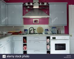 Small Fitted Kitchen White Oven And Kettle On Hob In Worktop In Fitted White Unit In