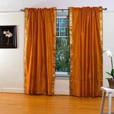 redoubtable faux silk double orange curtains hang on bronze curtain bar added creamy wall painted also