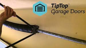 How many times do you turn a garage door spring?