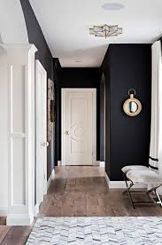 Black and white interiors. The black wall paint color is Benjamin Moore  Onyx. White trim paint color is Benjamin Moore Swiss Coffee Sarah St. Amand  Interior ...