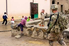 u s department of defense photo essay  an afghan child waves at u s iers conducting a patrol through a village near bagram airfield