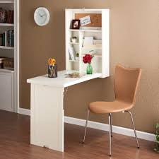 maximizing small spaces using creative wood wall mounted fold down desk table as small cabinet painted with white color and brown leather armless chair with