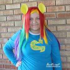 we bought a rainbow wig instead of coloring her hair