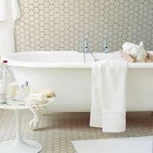 white bathroom flooring. white bathroom with freestanding bath and tiled floor flooring