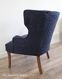 armchair slipcovers the slipcover maker navy blue linen chair gingham channel back patio furniture monitor riser ikea british grey nightstand cool leather