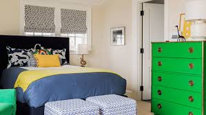 beach house bedroom furniture. a vintage kelly green campaign dresser plays well with varying shades of blue and bright yellow beach house bedroom furniture