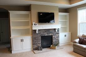 white built ins stone fireplace ideas