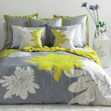 home ashley duvet cover set instantly brings a bright and fresh look to your bedroom with a crisp white and citron green chrysanthemum designs on a pewter