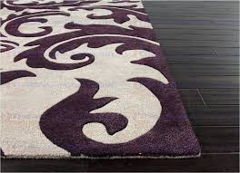 plum colored kitchen rugs great purple area moody rug trends lovable blue aloha hand tufted abstract