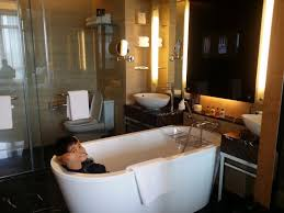 the majestic hotel kuala lumpur the see through glass bathroom comes with a bathtub