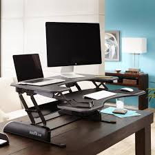 the pro plus 36 is a standing desk sized to accommodate