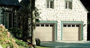 house with 2 garage doors