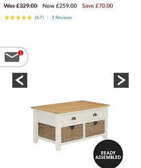 brand new cream oak coffee table with seagrass baskets