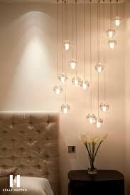 bedside lighting ideas. the simple headboard makes lights stand out bedside lighting ideas
