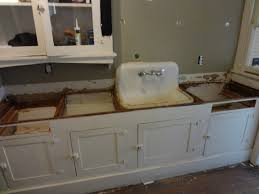 kitchen 1920s kitchen sink table vintage cabinets wall tiles