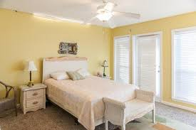 bedroom astounding yellow master bedroom decoration with yellow painted wall combine white window blinds over