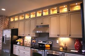 lighting above cabinets. Lighting Above Kitchen Cabinets Using Soft Yellow Led Bulbs Also Stainless Steel Vent Hood Over Slide T