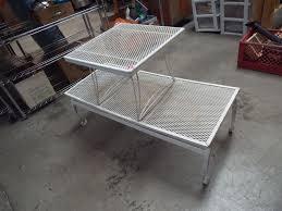 two vintage metal patio tables