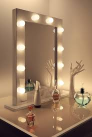 vanity table lighting. Glass Top Makeup Vanity Table With Tall Lighted Mirror And Hand Jewelry Holder Lighting