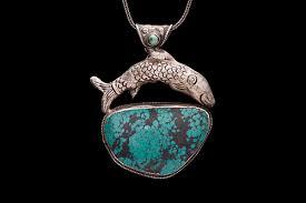 a tibetan antique silver pendant with a