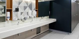 male restroom with automated sinks and soap dispensers