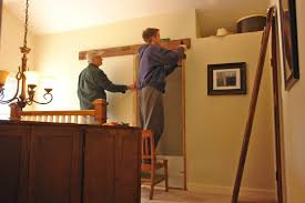 then he mered how high the pine board needed to be hung unfortunately this merement was not high enough and it had to be re done