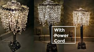 diy dollar tree glam lamp with power cord and a lot of bling home decor
