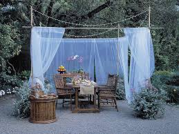 outdoor living space with sheer curtain divider
