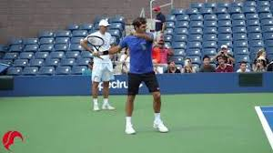 I started throwing forehand with a stacked finger gun grip, with my middle finger making contact with the inner rim and my pointer stacked behind it. Dimitrov Forehand Talk Tennis