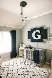 baby boy nursery decorated with large wall alphabet and modern rug 15