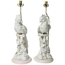 pair of large scale hollywood regency blanc de chine figural parrot lamps