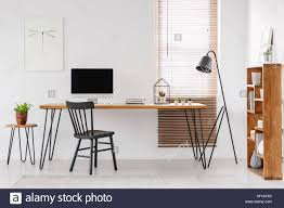 Next office desk Ideas Lamp Next To Wooden Desk With Computer Monitor In Home Office Interior With Poster Real Photo Alamy Lamp Next To Wooden Desk With Computer Monitor In Home Office