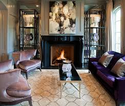 furnitures glamour living room with purple sofa and rectangle black gold coffee table near fireplace