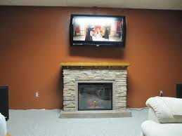 electric fireplace with mantel and stone