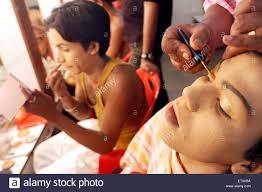 male artist applying eye makeup and lip colors for show bin baicha tamasha india no mr