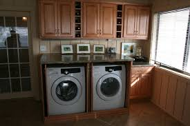 ... Home Decor Divine Laundry Room Design Ideas With Brown Wooden Storage  Cabinets And Built In Machines ...