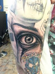 Realistic Eye Tattoo On Biceps Tattooshuntcom