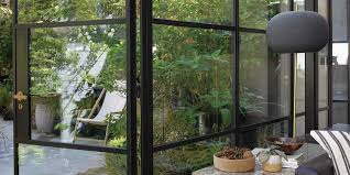 black steel framed windows are bang on trend and it s easy to transform your old aluminium windows to capture this look with a coat of paint