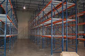 office racking system. racking system installed with modular shipping office in the background far right being