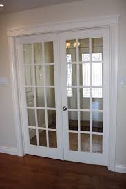 interior sliding french door in white with silver metal hardware