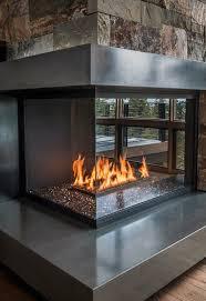 modern polished concrete and glass corner fireplace design