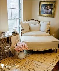 comfortable and nice white oversized chair with ottoman in the corner room near pretty roses in
